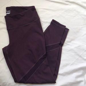Maroon leggings with mesh detail